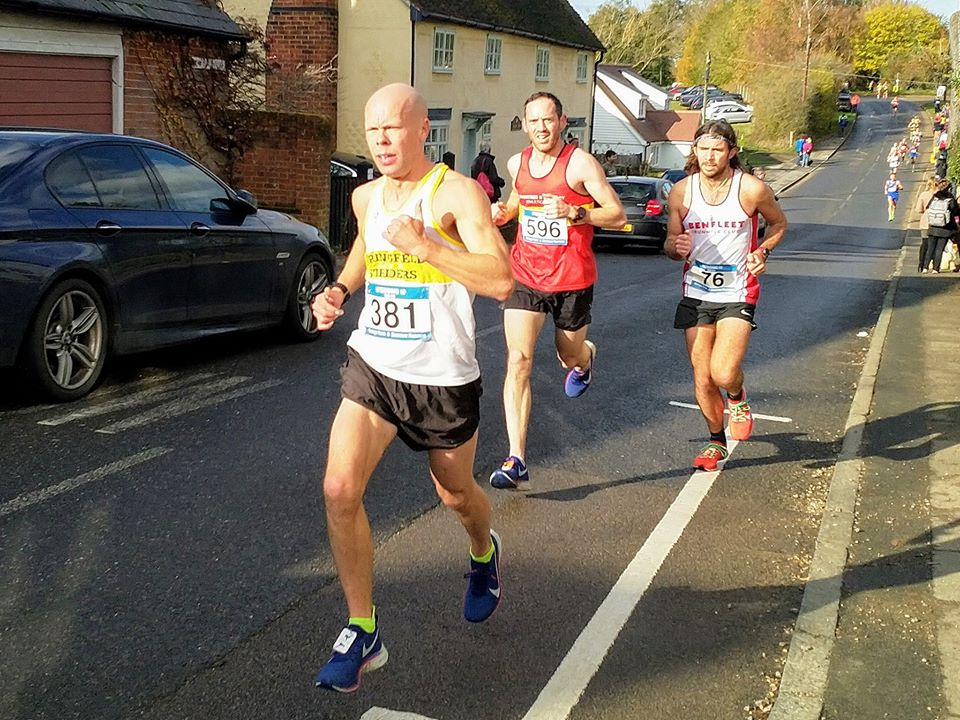 Mark wearing his striders vest leading the race